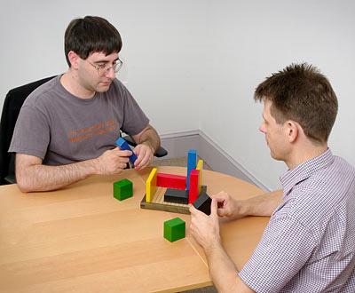 Inverse Spatial Logic Game