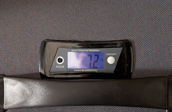 Self-Weighing Suitcase