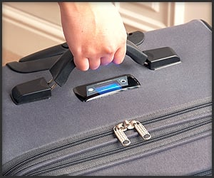 Self-Weighing Suitcase