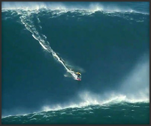 Surfer Rides 90ft. Wave