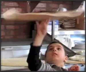 Kid Tosses Pizza (Like a Boss)
