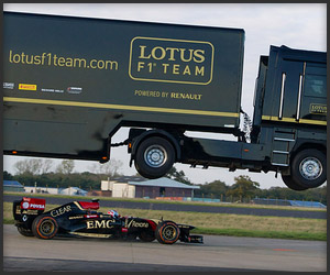 Semi Truck Jumps F1 Car