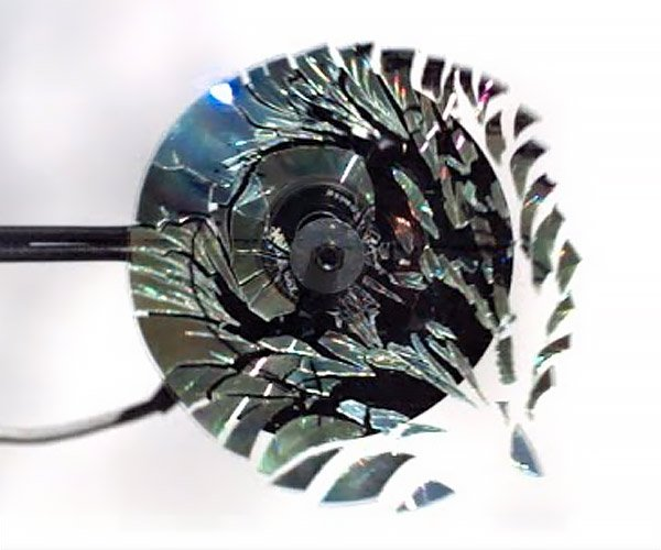 Shattering a CD in Slow-Mo