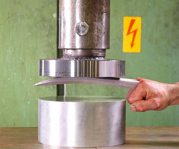 Hydraulic Press vs. Adamantium