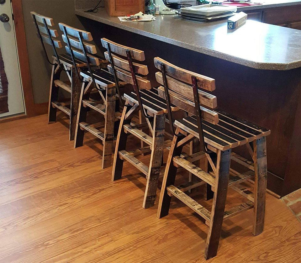 These Bar Stools Are Made From Old Whiskey Barrels