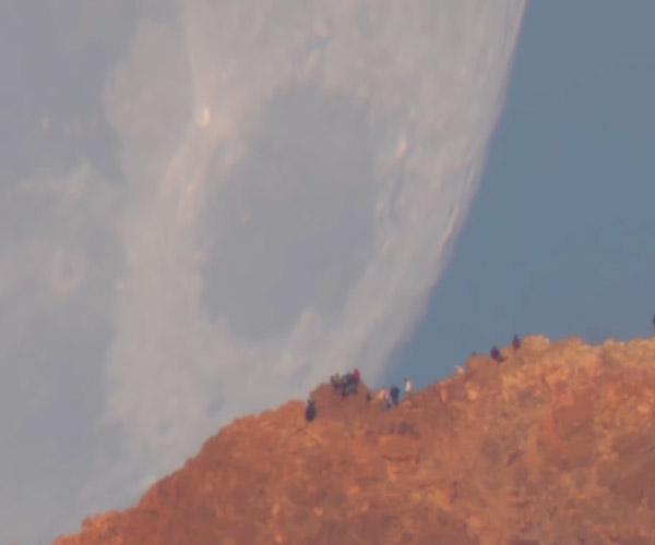 Moon Sets Behind a Volcano