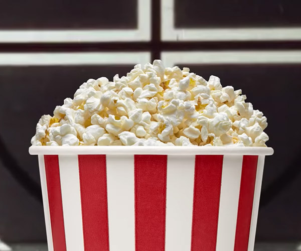 Why We Eat Popcorn at The Movies