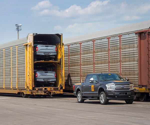Truck Tows a Train
